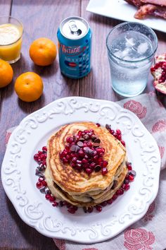 Chocolate Chip Pomegranate Pancakes from The Girl In The Little Red Kitchen | Light and fluffy pancakes made with seltzer water and topped with fresh pomegranates and chocolate chips. #drinkvintage #seltzer