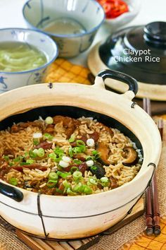 Claypot Chicken Rice Claypot Chicken Rice is a delicious one-pot meal that can be easily prepared at home. The addition of mushrooms and Chinese sausage makes it even tastier. Claypot Recipes, Rice Recipes, Asian Recipes, Chicken Recipes, Cooking Recipes, Ethnic Recipes, Claypot Rice Recipe, Yummy Recipes, Cooking Wine
