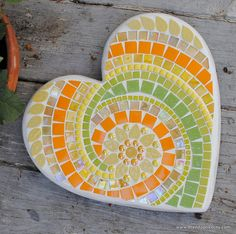 This gorgeous yellow and lime green mosaic stepping stone would look great in the spring nestled in a bed of daffodils, or all summer long