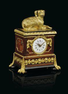 AN ORMOLU-MOUNTED KINGWOOD, TULIPWOOD, AMARANTH AND EBONY STRIKING AUTOMATON MANTEL CLOCK   THE HOUND AUGSBURG, 17TH CENTURY, THE CASE PROBABLY AUSTRIA, LAST QUARTER 18TH CENTURY   automaton, Clocks   Christie's Large Vintage Wall Clocks, Antique Clocks, Large Clock, French Clock, Dog Table, Classic Clocks, Wall Clock Online, Mantel Clocks, French Empire