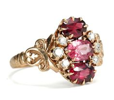 14K rose gold ring set with pink tourmaline, garnets, and diamonds, c. 1890.