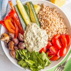 Farro and roasted vegetable grain bowl is a healthy vegetarian lunch or light dinner topped with a creamy spinach and kale dip.