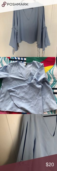 Topshop bell sleeve top Baby blue bell sleeve top. Open arm detail.  US 10 NOTE: Topshop runs about 2 sizes small, so this will fit like a 6-8 Topshop Tops Blouses