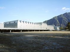 Pia Durisch and Aldo Nolli's design for a school in Gordola, Switzerland, sits gleaming in the commercial zone of the small town, paying tribute to the area's industrial structures, whilst its silhouette also refers to the mountains. Future Buildings, Centre Commercial, Flood Zone, School Building, Education Center, New Age, Small Towns, Switzerland, Deck