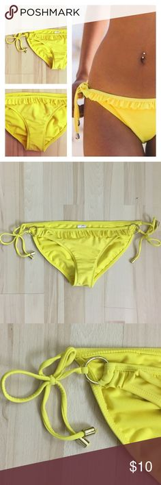 Xhilaration Yellow Bikini Bottoms Ruffle Front (M) Fun & Super cute!  Yellow bikini bottoms by Xhilaration featuring ruffles on the front that make the bottoms pop.  Women's size medium.  Shell: 82% nylon, 18% spandex.  Lining: 100% polyester. With the exception of the tag (see picture), these bikini bottoms are in great condition. Xhilaration Swim Bikinis