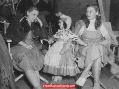 On the set of 'The Wizard of Oz,' 1939. Judy Garland, Olga Nardone in her Munchkin costume, and Judy's stand-in Bobbie Koshay.