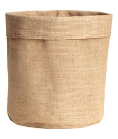 Check this out! Small jute storage basket with laminated inside. Diameter 8 3/4 in., height 9 3/4 in. - Visit hm.com to see more.