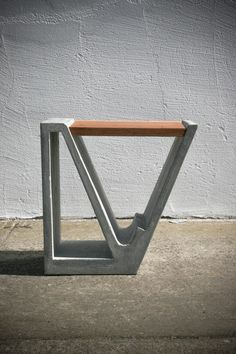 A Concrete and Wood Multipurpose Piece of Furniture