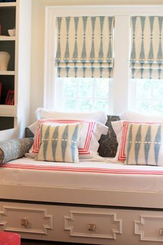So pretty.  Love the roman blinds, and pillows.  Built in window-seat, shelves, storage.