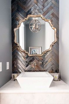 it's all about the shine in this intriguing powder room