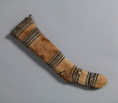 Sock Date: 12th–13th century Geography: Egypt, Fustat Culture: Islamic Medium: Cotton Dimensions: H. 19 1/2 in. (49. 5 cm) W. 6 in. (15.2 cm)