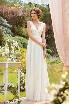 Made to order  An elegant Wedding dress with a complicatedly decorated Vintage style French lace bodice and a falling chiffon skirt. Lace cloth