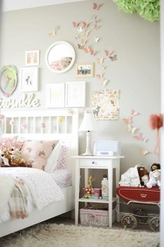 Butterflies and eclectic frames. This is a lot like the vision I have had for my little girl's bedroom