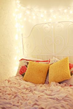 Flashes of Style- the lights around the bed to set that magical fairy image