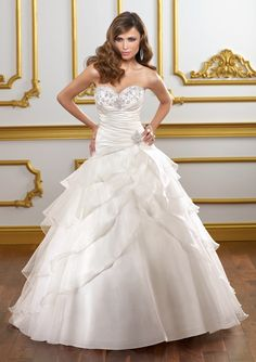Style 1806 - Embroidery on organza.  Colors Available: White/Silver, Ivory/Silver.