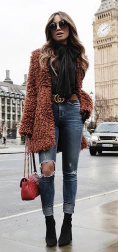 #winter #outfits brown fur coat with blue distressed denim jeans and black booties outfit