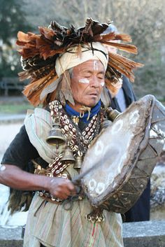 Even though Shaman Magar Jankiri is a man, everything about his clothing, the bells, the headdress is that of a woman shaman... Someday the women of Nepal shall be shamans again.