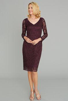 Siri. V-neck sheath lace dress with illusion back and 3/4 sleeve. Sash is sold seperately.