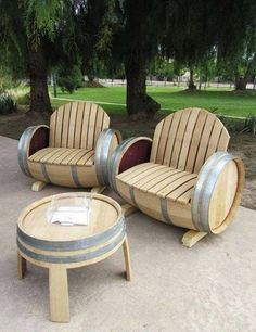 Chairs made out of wine barrels !  Genius