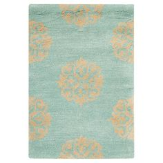 Anchor your living room seating group or define a space in the den with this hand-tufted wool rug, showcasing a scrolling medallion motif. ...