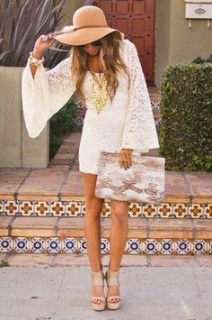 Gorgeous white stylish lace summer mini dress with leather cute plan clutch and high heels sandals and beach brown cute cap and gorgeous nec...