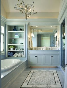 Beautiful Soft Blue Bathroom with Tile Rug