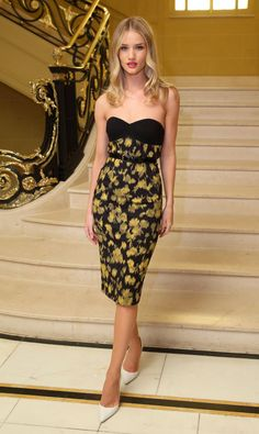 Pin for Later: 73 Times Rosie Huntington-Whiteley's Sexy Looks Scorched the Red Carpet Wearing a strapless Michael Kors pencil dress to a dinner in celebration of the designer in London.