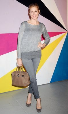 Kelly Rutherford wears the 811 Mid-Rise Skinny Leg in Wink