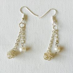 Made a pair of freshwater pearl and crochet wire bead dangling chain earrings!