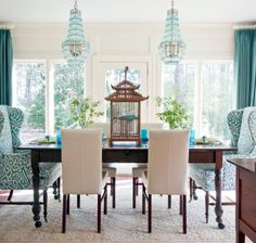 I'm not loving the teal colors, but I love the idea of a wingback chair, upholstered in a graphic print, put at the end of the table. Design Chic: Delicious Dining