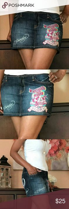 """👗SALE👗Ed Hardy """"Tattoo You Glory"""" Bling Skirt Ed Hardy """"Tattoo You Glory"""" Bling Mini Denim Skirt By Christian Audigier  Size 29 Color: Dark blue jean with turquoise, pink, white, yellow rhinestones Style: 5 Pockets Tattoo You Glory rhinestone embellishments   Approximate Measurements * Length 13"""" long * Waist flat across the hips 19"""" wide.   Has the word """"TATTOO"""" on the back  EXCELLENT CONDITION Ed Hardy Skirts Mini"""
