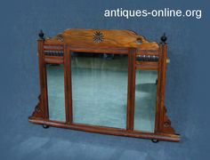 Beautiful carved triple Mahogany Over Mantle mirror with carved detail.  Carved top decoration with finials to either side.  Small bun feet to base.  Excellent condition for age.  Measures 91 cm X 60 cm