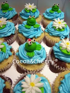 Frog cupcakes - These were a birthday gift for a nurse, the frog in the middle is a nurse!!! Marble, filled with chocolate and buttercream frosting.