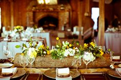 log centerpieces | These centerpieces are AMAZING! We are so smitten over these log vases ...