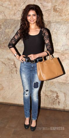 Feb, 14: Karishma Tanna in a lace-sleeved black blouse, skinny jeans and black pumps at screening of friend Kangana's Queen  (Photo: Varinder Chawla)