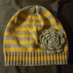 Striped beanie Great for fall and winter! Grey and mustard stripes with cute flower. Accessories Hats