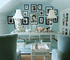 cape cod home office in pale blue. eclectic furniture and black/white photos.