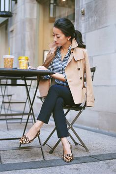 summer outfit ideas for work: classic trench over navy and white with leopard shoes