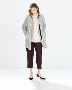 Image 1 of ZIPPED BOUCLÉ COAT from Zara