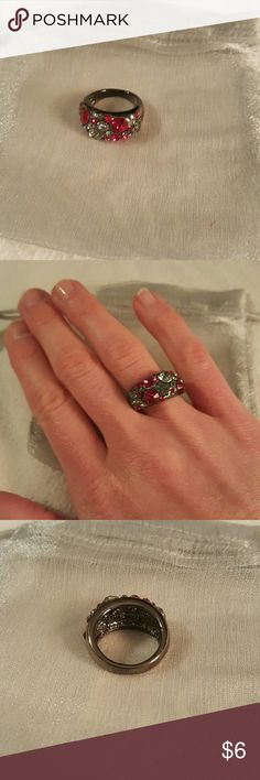 Fun costume ring. Red & grey rhinestone with titanium colored band. Costume jewelry.  Not sure of the size. Maybe 7 or 8. Jewelry Rings