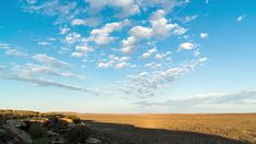 A static timelapse of a typical rocky Karoo landscape as the sun rises to light up the scenery with slow moving clouds moving in over a bright blue sky. Moving Clouds, Sky View, Stock Footage, Light Up, Sunrise, Scenery, African, Bright, Landscape