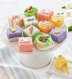 Easter dinner is complete with an elegant assortment of our delectable petit fours. Each miniature butter rich cake is filled, dipped in real chocolate and decorated by hand with bunnies, chicks and carrots, birds nests and sweet eggs. Looks yummy! #teelieturner #easter #teelieturnershoppingnetwork #eastertreats www.teelieturner.com