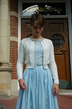 The short sweater pattern looks sweet with this fairly plain vintage style dress.