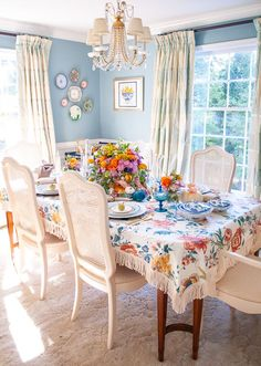 Set a memorable fall table with pastel hues and pretty chintz filled with vintage tableware, bold florals, candles, and pumpkins!
