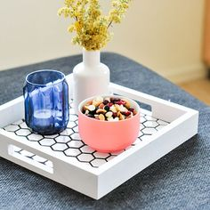 Use leftover tile to create a tray to hold everything from snacks and drinks…