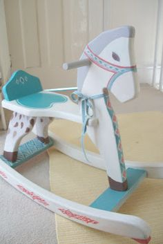 Little painted rocking horse for a child. by Clare Collingridge