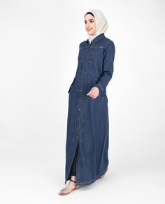 This denim Jilbab features antique buttons & top stitch detail that reminds you of the classic denim jackets. This is denim Jilbab will never go out of style Denim Abaya, Abaya Fashion, Fashion Outfits, Abaya Designs, Dreadlocks, Islamic Fashion, Islamic Clothing, Denim Coat, Muslim Women