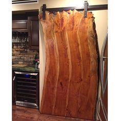Rustic, live edge, sliding barn door. Hung with Rustica Hardware's Industrial hanger.