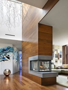 "Concrete Fireplace With Wood Clad Chimney from our Daily Design Collection""Wood and Concrete: A Match Made in Heaven"". See more at HomeDesignBoard.com."