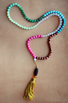 will someone buy for my birthday?Rainbow Gemstone Quartz Goldstone Jade Mala by FadingAmaranth, $25.00